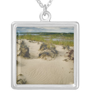 View from a sandy hilltop of lakes and hills on silver plated necklace