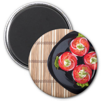 View from above on a dish with fresh sliced tomato magnet