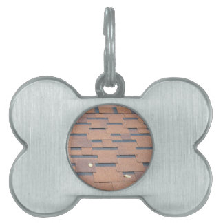 View from the roof shingles closeup brown pet ID tag