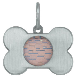 View from the roof shingles closeup brown pet tag