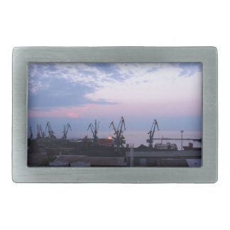 View of a cargo seaport against the evening cloudy belt buckle