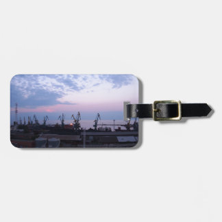 View of a cargo seaport against the evening cloudy luggage tag