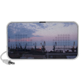 View of a cargo seaport against the evening cloudy portable speaker