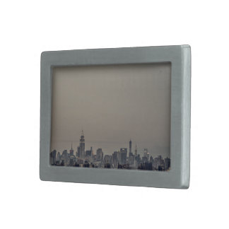View of a city at dawn belt buckle