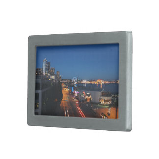 View of a city at night rectangular belt buckles