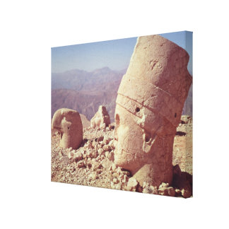 View of a colossal head and an eagle stretched canvas print