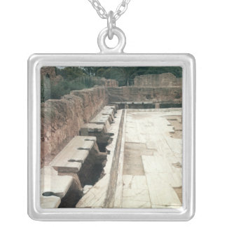 View of a communal lavatory square pendant necklace