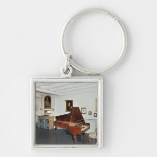 View of a room with a grand piano keychain