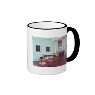 View of a room with a grand piano mugs