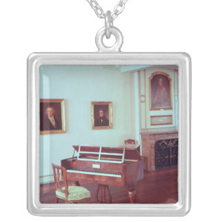 View of a room with a grand piano silver plated necklace