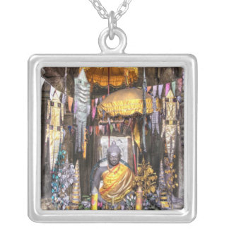 View of altar area inside Buddhist temple, Silver Plated Necklace