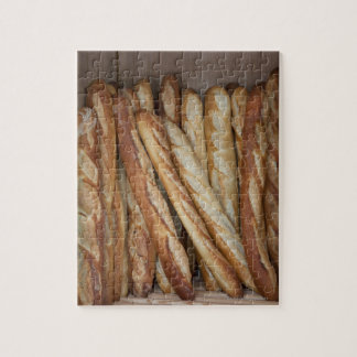 view of bread loaves in bakery window display jigsaw puzzle