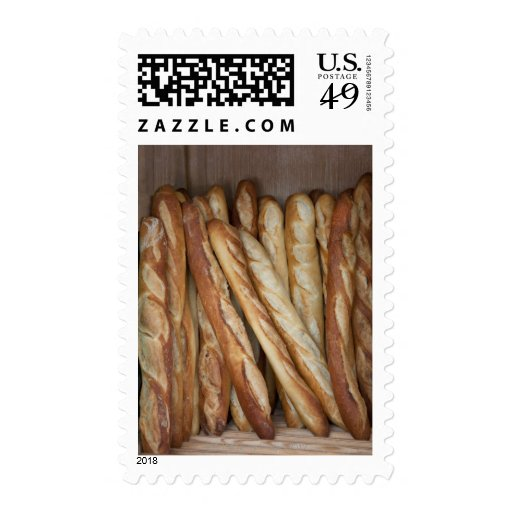 view of bread loaves in bakery window display postage