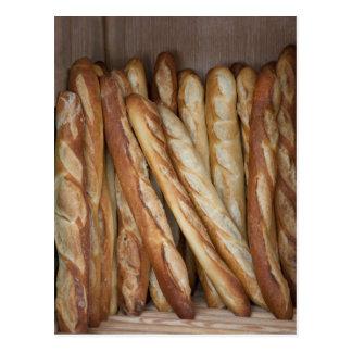 view of bread loaves in bakery window display postcard