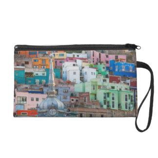 View of city buildings wristlet purses