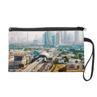 View of city metro line and skyscrapers wristlet clutches