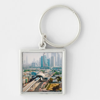 View of city metro line and skyscrapers keychain