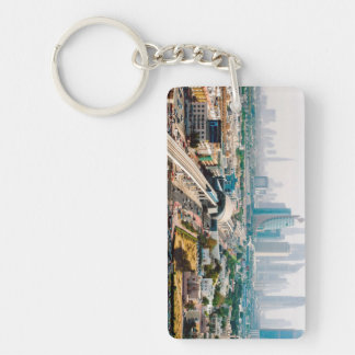 View of city metro line and skyscrapers acrylic key chains