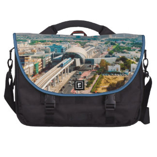 View of city metro line and skyscrapers bag for laptop