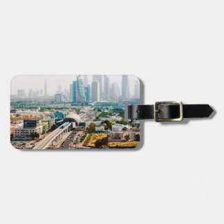 View of city metro line and skyscrapers luggage tag