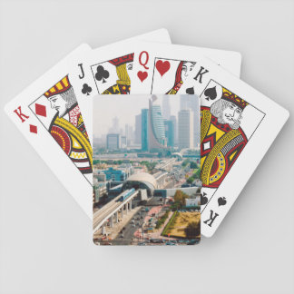 View of city metro line and skyscrapers playing cards