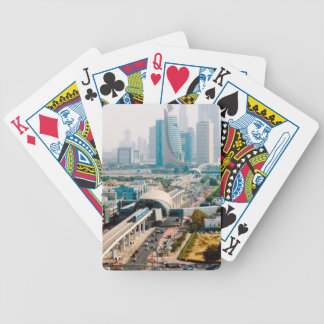View of city metro line and skyscrapers bicycle playing cards