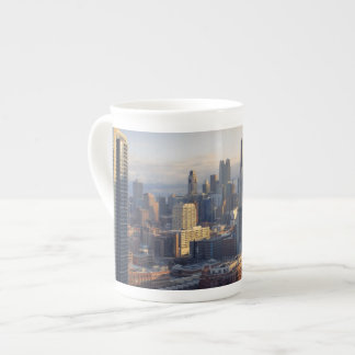 View of cityscape with fantastic light porcelain mugs