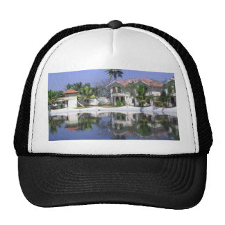 View of cottages and lagoon water in Alleppey Mesh Hat