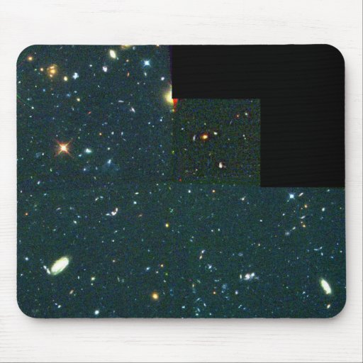 View of Distant, Faint Galaxies Reveals Young Gala Mouse Pad