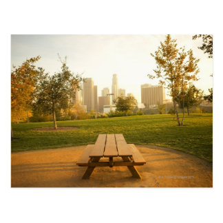 View of downtown from picnic in urban park postcard