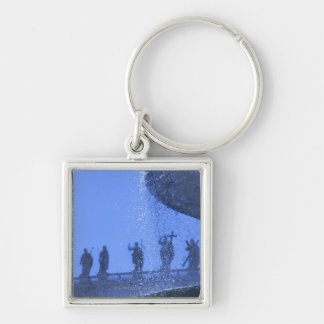 view of falling fountain waters near saint Silver-Colored square keychain