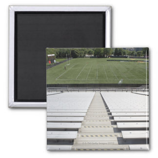 View of football field from empty bleachers magnet
