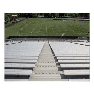 View of football field from empty bleachers poster