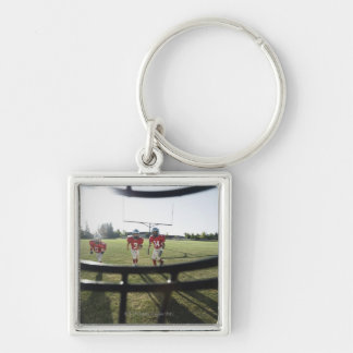 View of football players and field from inside keychain