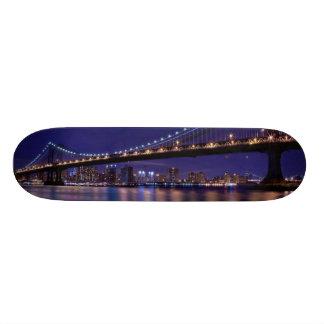 View of Manhattan bridge at night Skateboard