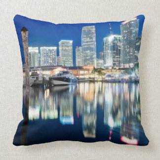 View of skyline with reflection in water, Miami Throw Pillows
