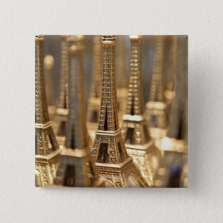 view of small eiffel towers for sale to tourists button
