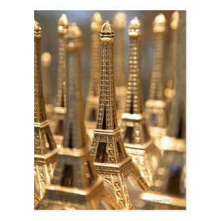 view of small eiffel towers for sale to tourists postcard