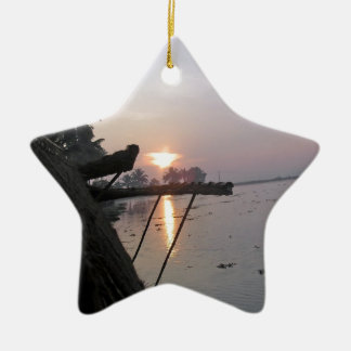 View of sunrise from a houseboat window ceramic ornament