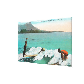View of Surfers Board Riding, One Taking a Canvas Print
