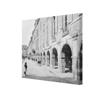View of the arcade of Place des Vosges Canvas Print