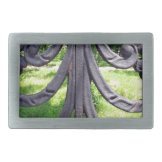 View of the city park through a lattice fence rectangular belt buckle