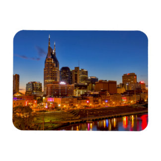 View of the city skyline at dusk magnet
