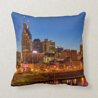 View of the city skyline at dusk throw pillow
