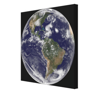 View of the full Earth and four storm systems Stretched Canvas Print