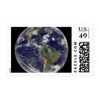 View of the full Earth and four storm systems Postage Stamp