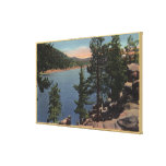 View of the Lake through the Pines Canvas Print