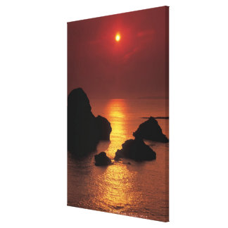 view of the sun setting over the sea canvas print
