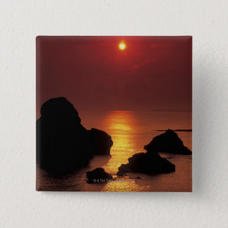 view of the sun setting over the sea pinback button