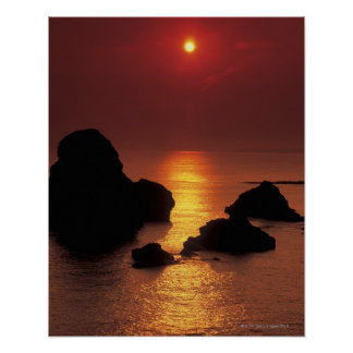 view of the sun setting over the sea poster